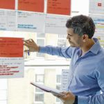 Project manager observes different ways to complete a project
